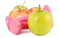 Pesas de gimnasia y manzanas Imagenes de archivo