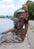 Pesca cogida pescador Fotos de archivo