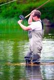 Pesca con la mosca (colata) Immagine Stock