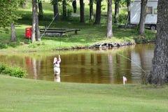 Pesca con la mosca (colata) Fotografie Stock