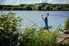 Pesca da rotação, dobrando, peixes de travamento imagem de stock royalty free