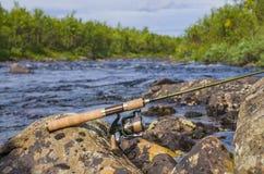 Pesca de la barra de giro con el carrete Imagen de archivo libre de regalías