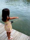Pesca de la muchacha Imágenes de archivo libres de regalías
