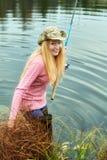 Pesca de la mujer Foto de archivo libre de regalías