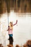 Pesca de la mujer Fotos de archivo libres de regalías