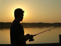 Pesca de la puesta del sol Fotografía de archivo