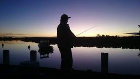 Pesca de la puesta del sol Foto de archivo
