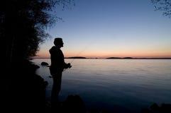 Pesca de la puesta del sol Foto de archivo libre de regalías