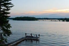 Pesca de la puesta del sol en el lago del este gull Imagen de archivo