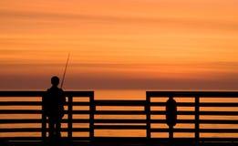 Pesca de la salida del sol Imágenes de archivo libres de regalías