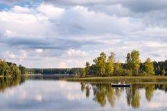 Pesca de la tarde Foto de archivo libre de regalías