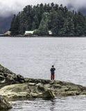 Pesca de la trucha del muchacho Fotografía de archivo libre de regalías