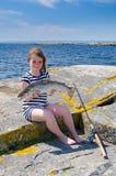 Pesca de mar da menina foto de stock royalty free