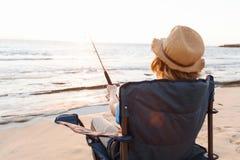 Pesca del adolescente en el mar Imágenes de archivo libres de regalías