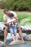 Pesca del figlio e del padre Immagine Stock Libera da Diritti