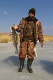 Pesca del ghiaccio. immagine stock