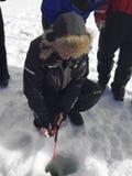 Pesca del hielo en el lago Inari Imágenes de archivo libres de regalías
