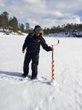 Pesca del hielo en el lago Inari Foto de archivo libre de regalías