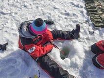 Pesca del hielo en el lago Inari Imagenes de archivo