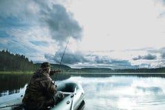 Pesca del hombre del barco Imagen de archivo