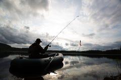 Pesca del hombre del barco Foto de archivo