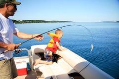 Pesca del hombre y del muchacho Imagen de archivo libre de regalías
