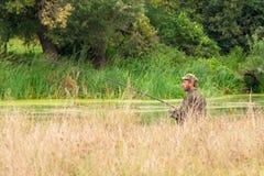 Pesca del pescador con el giro Fotos de archivo libres de regalías