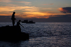pesca del pescador en el mar fotos de archivo libres de regalías