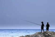 Pesca del pescador en la costa de Cerdeña Fotos de archivo libres de regalías