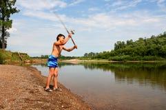 Pesca del ragazzo con la filatura Fotografia Stock