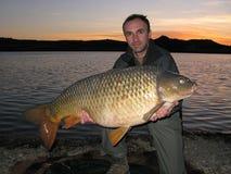 Pesca della carpa Immagine Stock