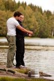 Pesca della donna e dell'uomo Fotografie Stock Libere da Diritti