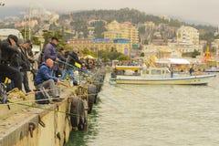 Pesca di massa sulla passeggiata Fotografie Stock
