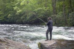 Pesca di mosca per la trota Fotografia Stock