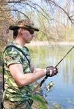 Pesca do homem novo Fotos de Stock