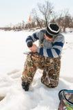 Pesca do inverno no rio Imagens de Stock Royalty Free