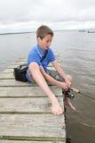 Pesca do menino no lago Imagens de Stock Royalty Free
