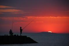 Pesca do nascer do sol fotos de stock