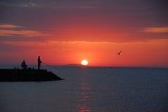 Pesca do nascer do sol foto de stock royalty free