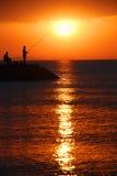 Pesca do nascer do sol imagem de stock royalty free