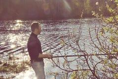 Pesca do pescador com giro Imagem de Stock