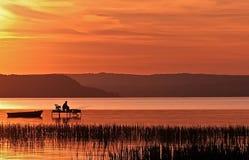 Pesca do por do sol Imagem de Stock