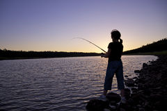 Pesca do por do sol Fotos de Stock Royalty Free