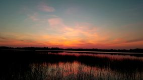 Pesca e tramonto arancio Fotografia Stock