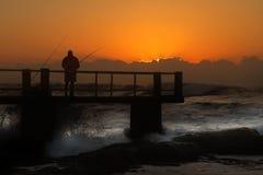 Pesca en el paseo marítimo Fotografía de archivo libre de regalías