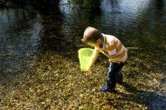 Pesca en la corriente Foto de archivo libre de regalías