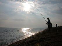 Pesca en la costa 1 fotografía de archivo libre de regalías