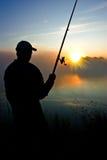 Pesca en la madrugada foto de archivo
