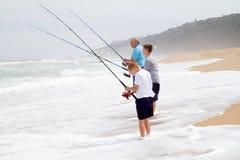 Pesca en la playa Foto de archivo
