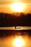 Pesca en la puesta del sol imagen de archivo libre de regalías